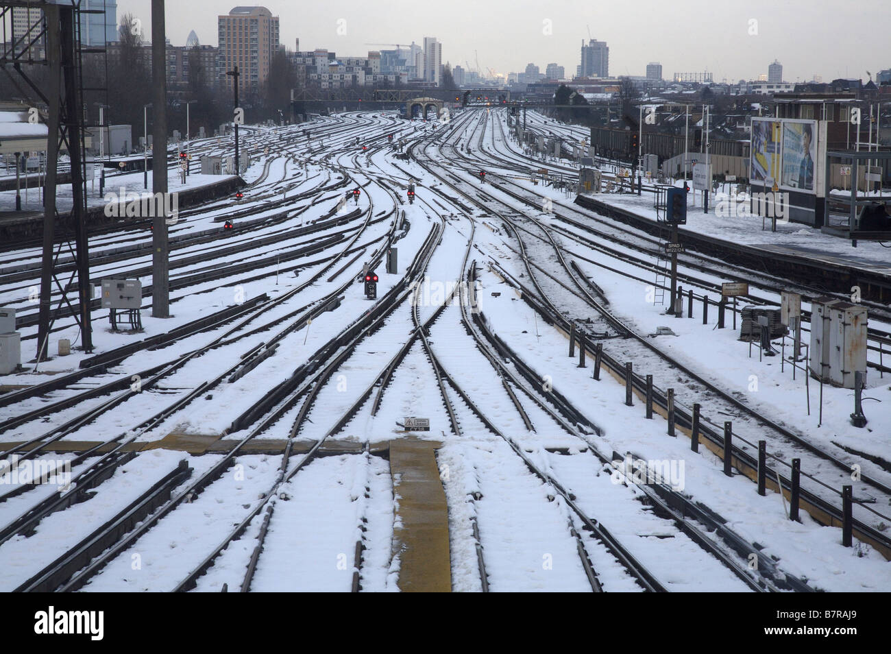 Snow on railway lines, Clapham Junction, south London, UK - Stock Image