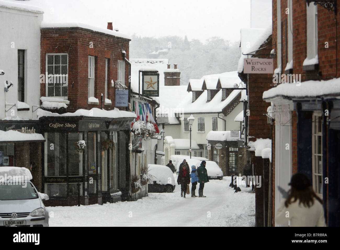 Snow covers Church Street in Godalming, England - Stock Image