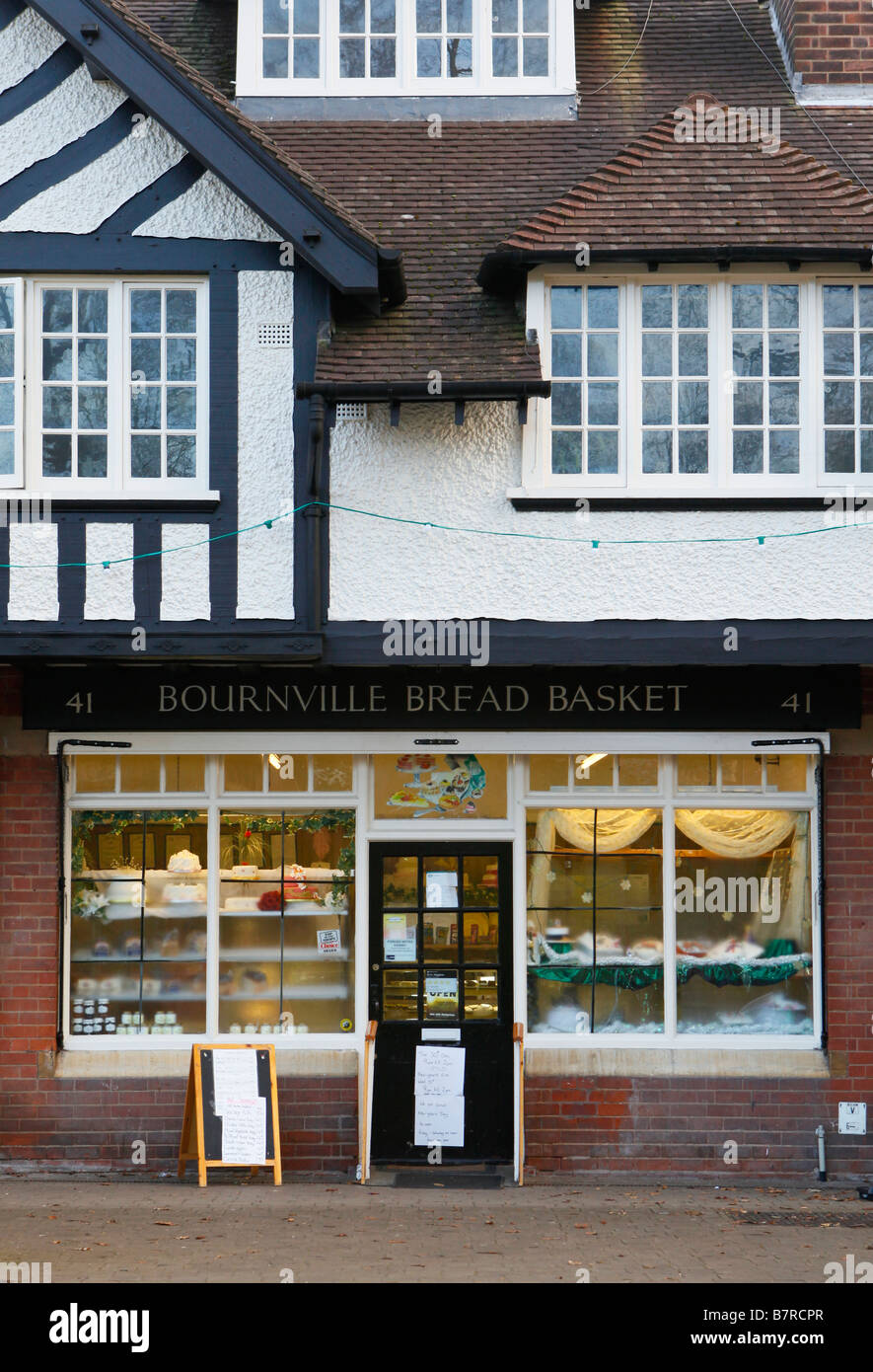 The timber framed shops in Bournville Birmingham West Midlands England - Stock Image