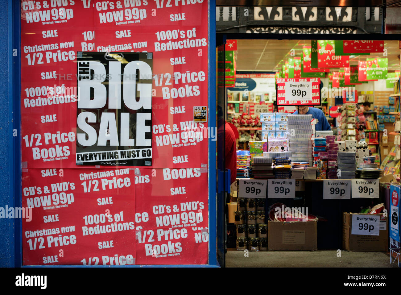 sale posters in the window of a shop in Shrewsbury - Stock Image