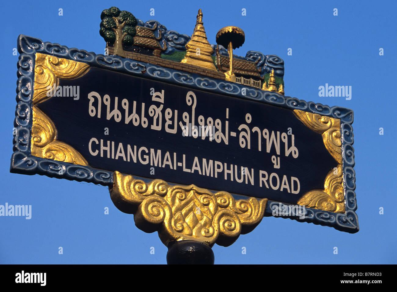 Bilingual Street Sign, Chiang Mai - Lumphun Road, Chiang Mai, Written in Thai Alphabet & English Roman Script, - Stock Image