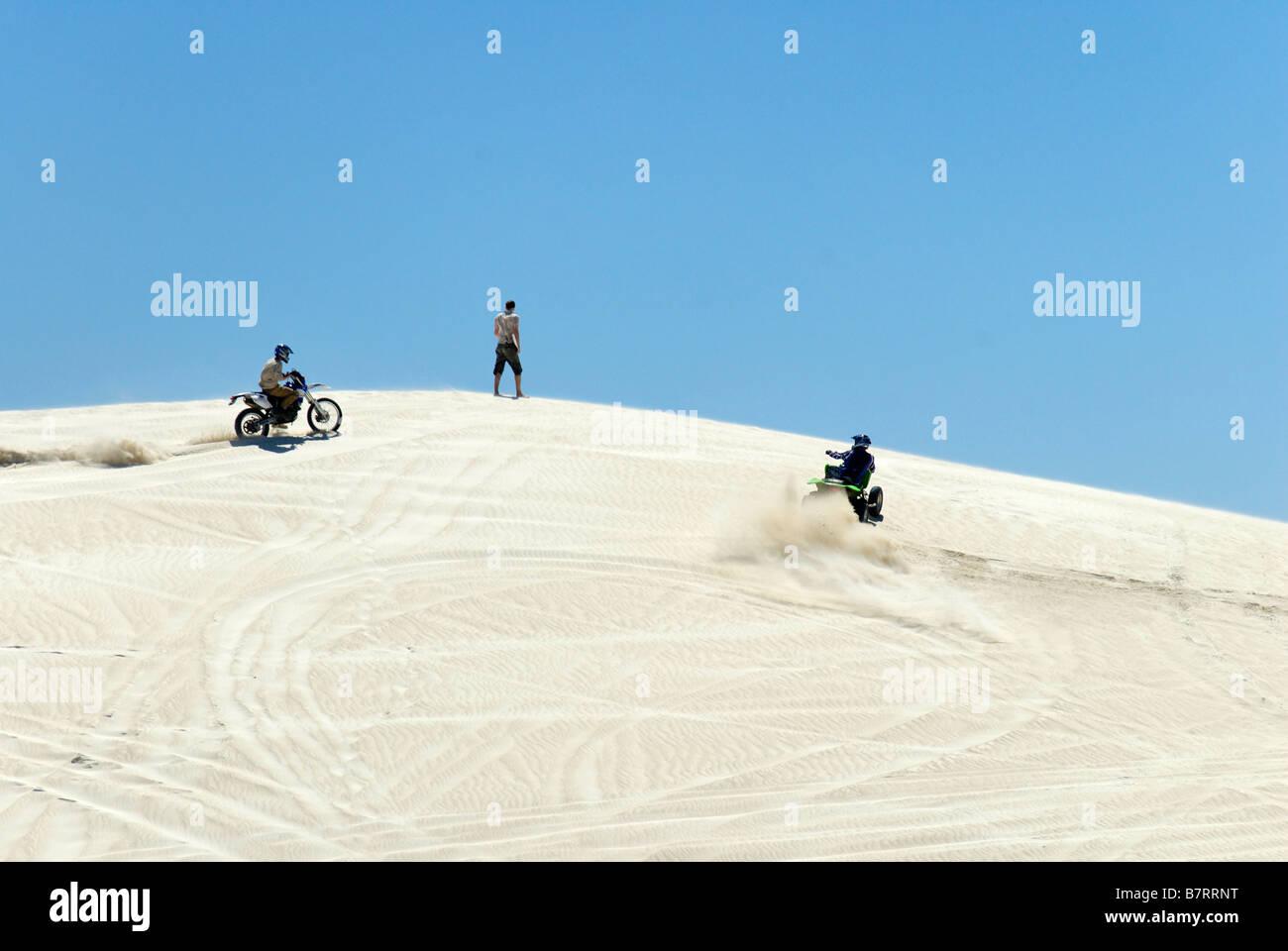 Quad bike motor bike on sand dunes outdoor leisure activities summer Western Australia - Stock Image