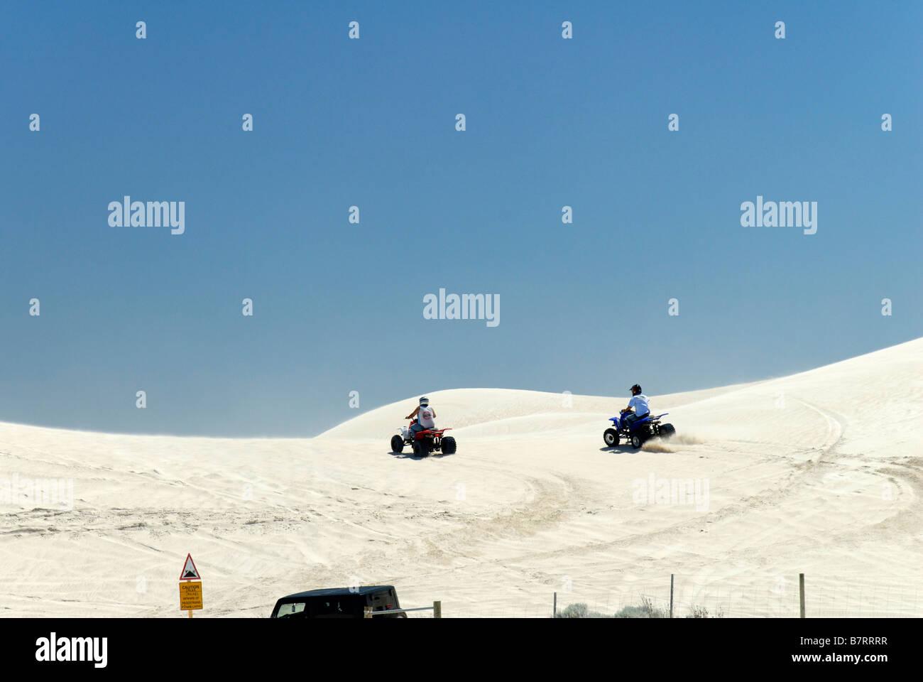 Quad bikes on sand dunes outdoor leisure activities summer Western Australia - Stock Image