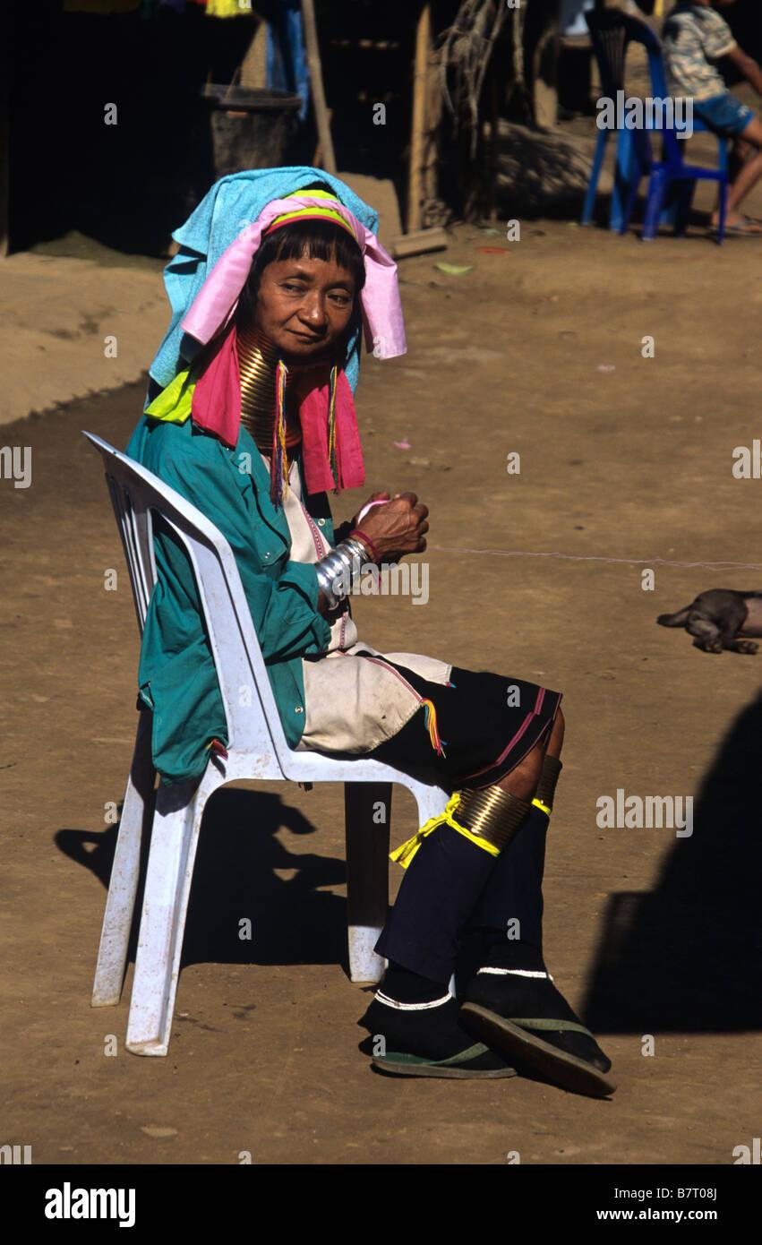 A Burmese Padaung (Kayan or Karenni) Long-neck Woman Spinning Wool, in Refugee Camp, Mae Hong Son Province, Thailand Stock Photo