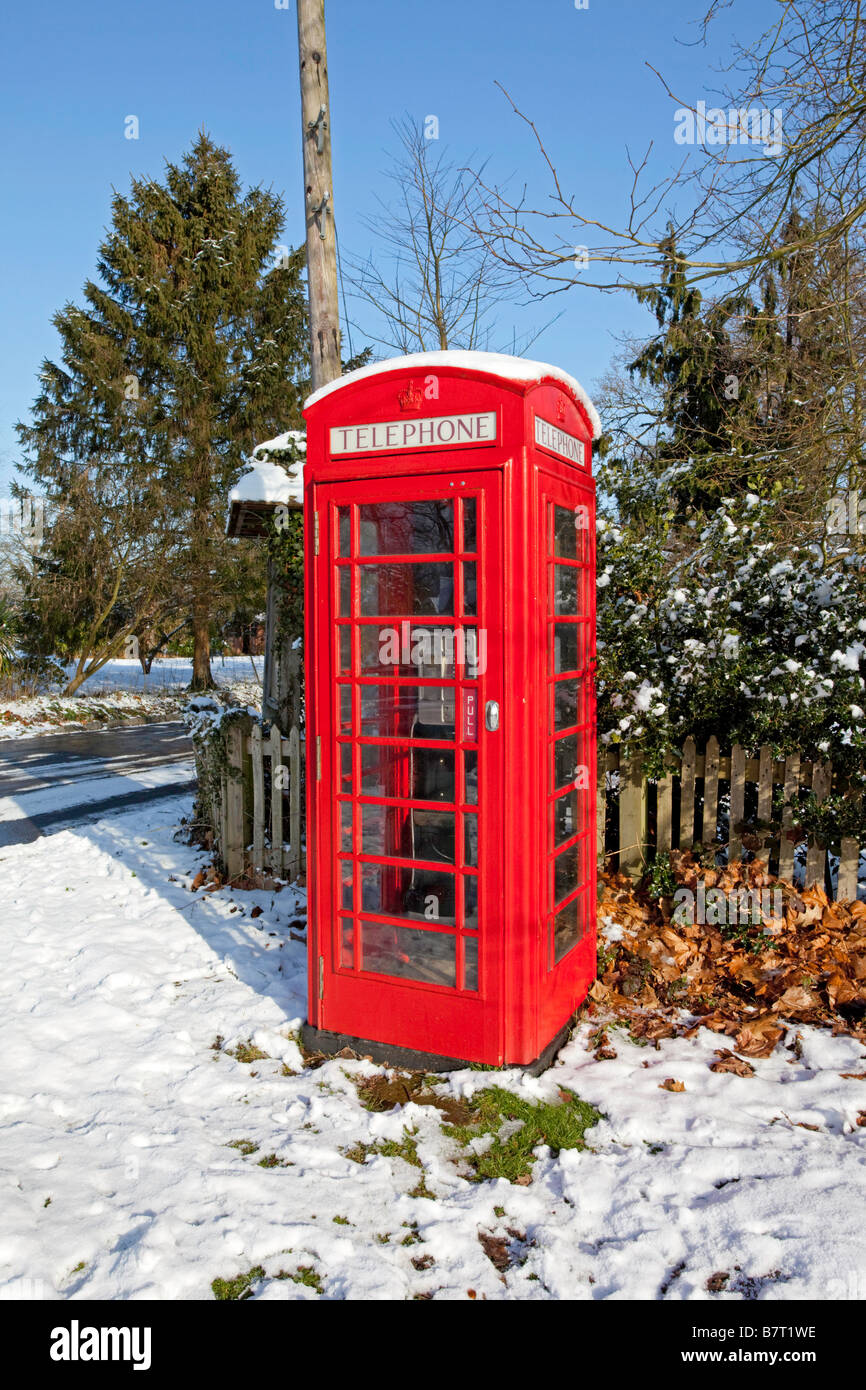 Old telephone box in the snow Leigh Surrey - Stock Image
