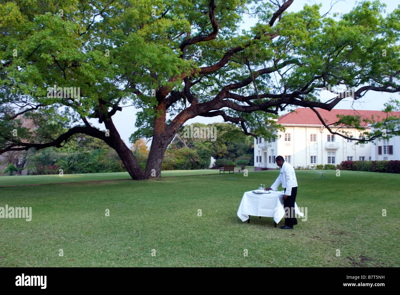 High tea being prepared on the lawn at Victoria Falls Hotel Stock Photo