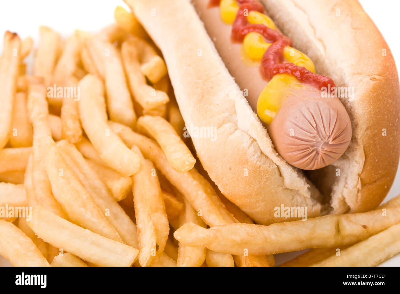 Fast food meal with hot dog and french fries. - Stock Image