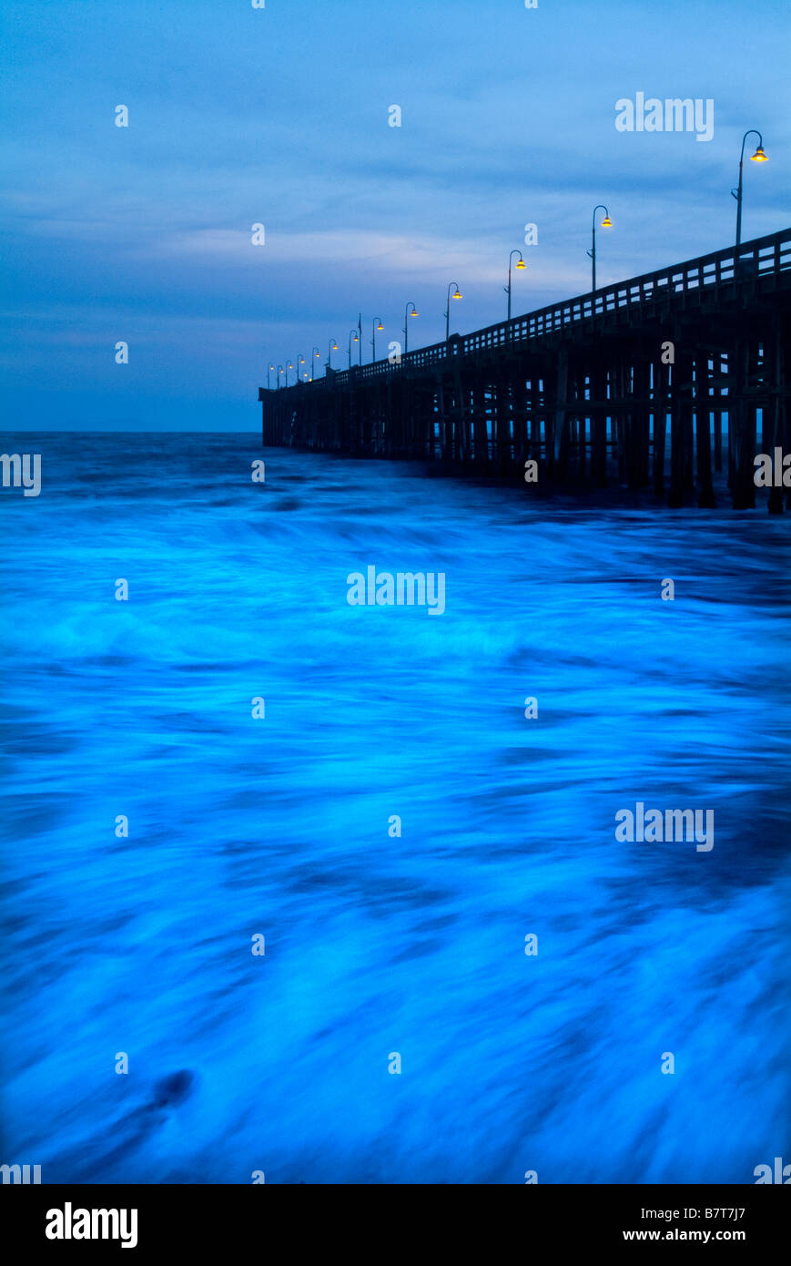Waves Ocean Motion Blur & Ventura Pier, Ventura California USA Stock Photo