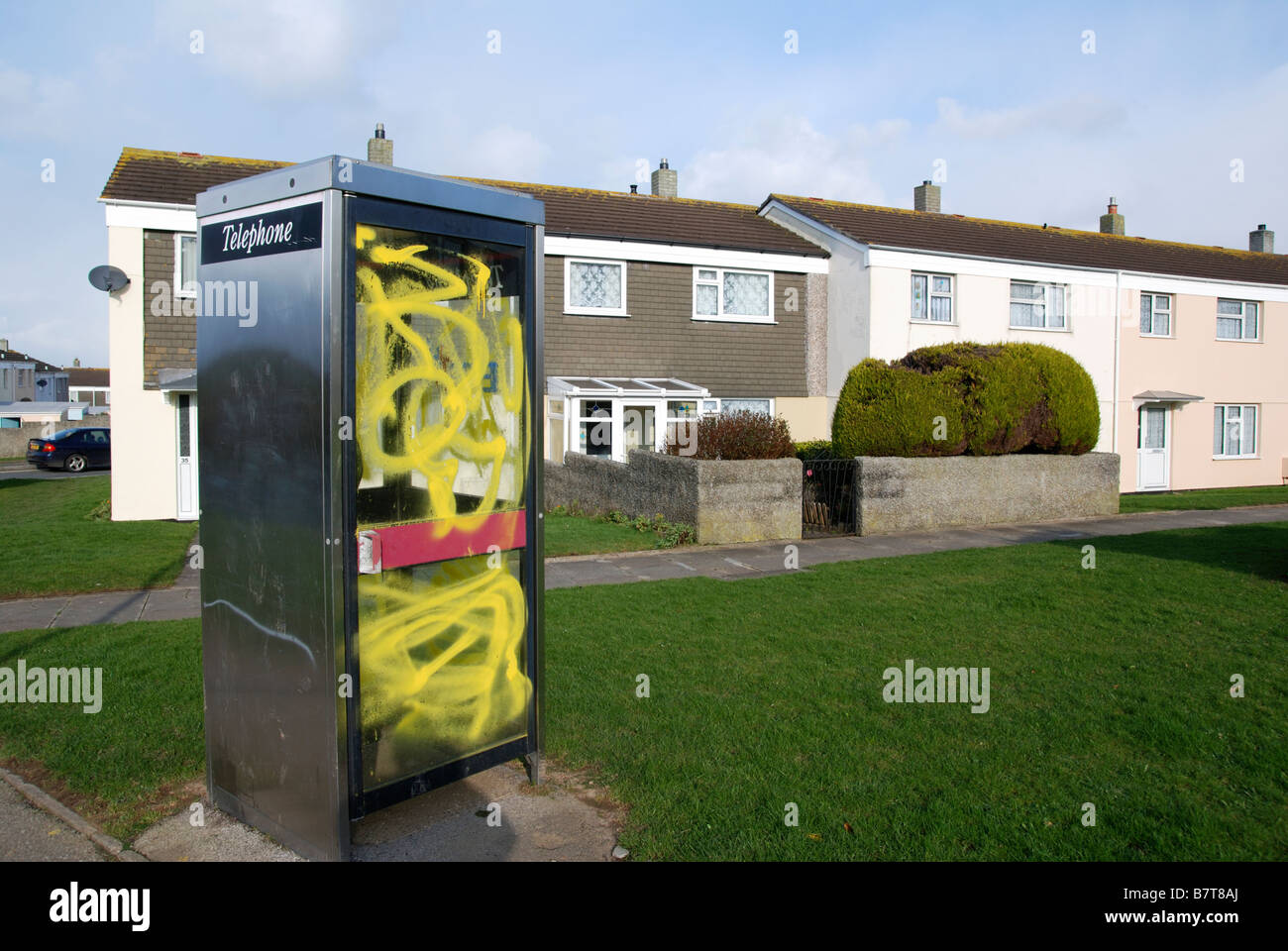 a vandalised telephone box on a council estate in redruth,cornwall,uk - Stock Image