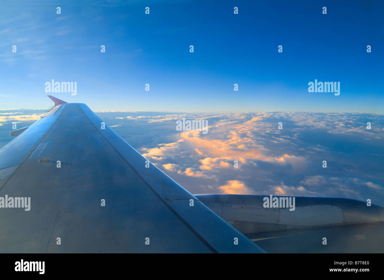 Airplane Wing With Blue Sky & Clouds - Stock Image
