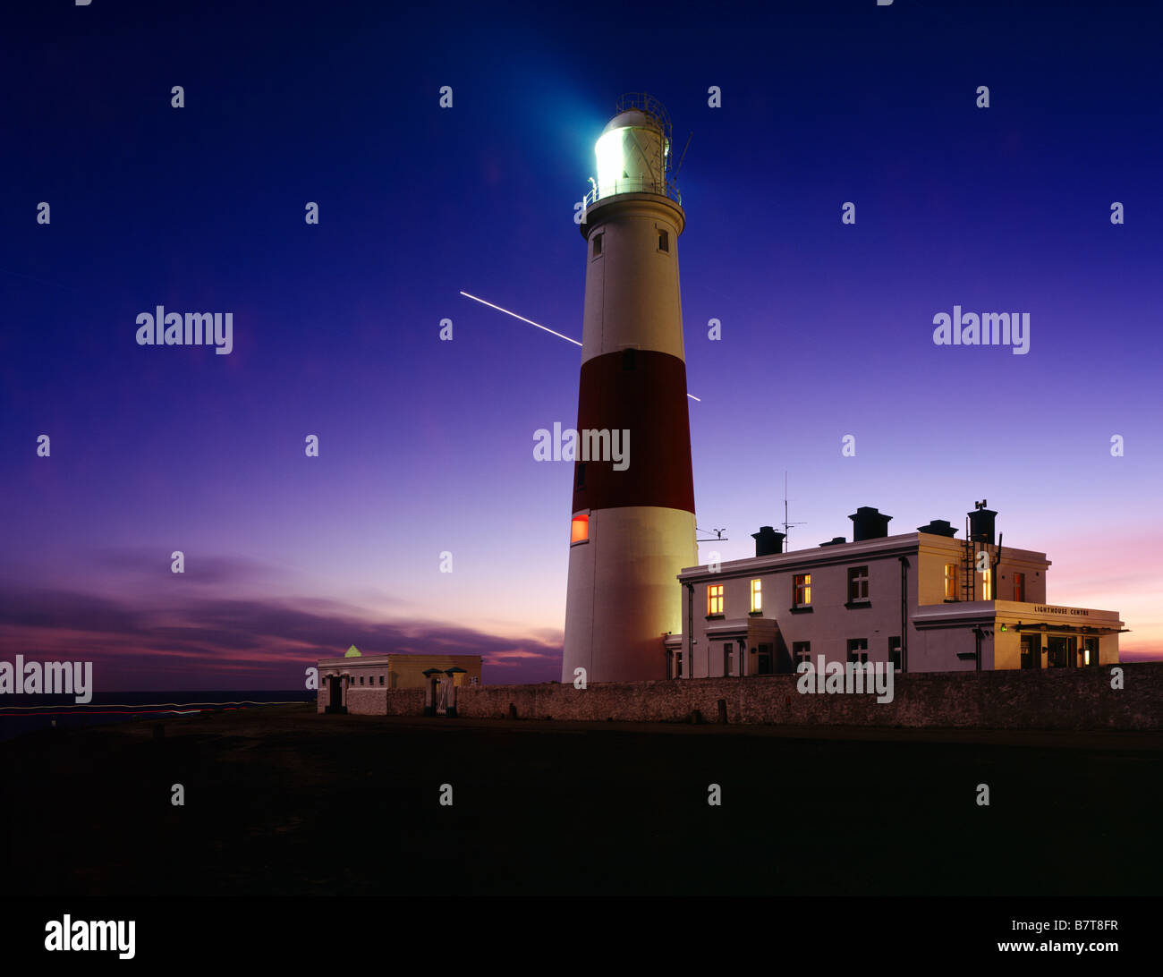 Portland Bill lighthouse at dusk on the Dorset Jurassic Coast England United Kingdom - Stock Image