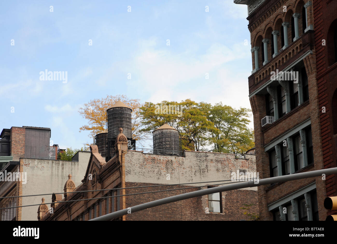New York City brownstone buildings - rooftops windows and sky - Stock Image