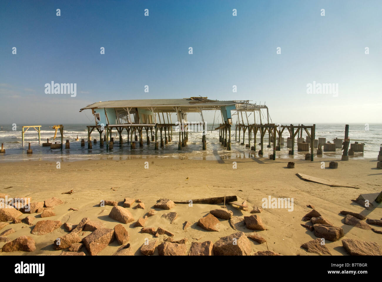 Remains of souvenir shop destroyed by Hurricane Ike in 2008 on beach at Seawall Boulevard in Galveston Texas USA - Stock Image