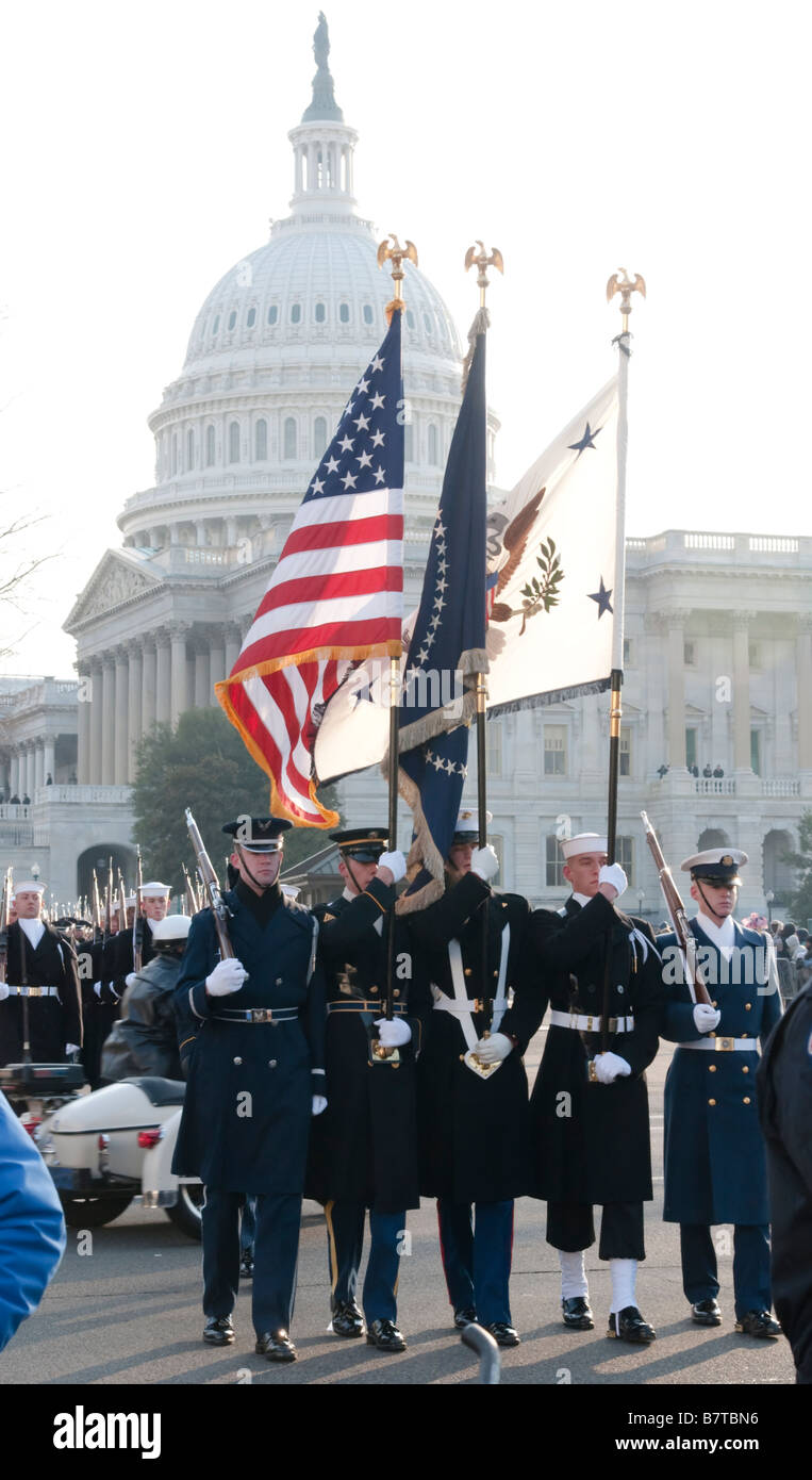 A U.S. Armed Forces color guard marches past the U S Capitol as part of the 2009 inaugural parade for President - Stock Image