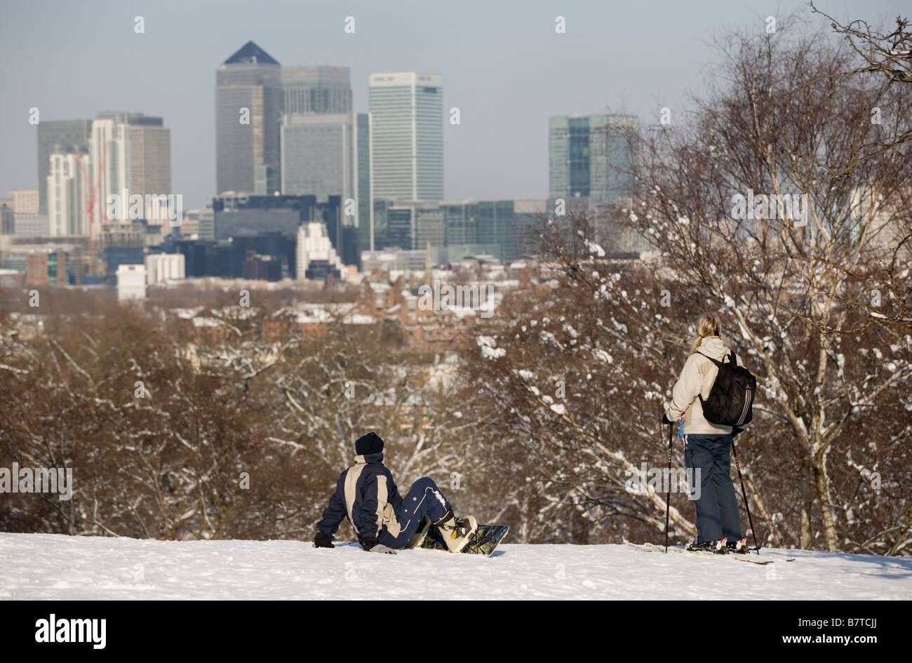 3/2/2009 Young couple pause to take in the views over Docklands from Greenwich Park London Stock Photo