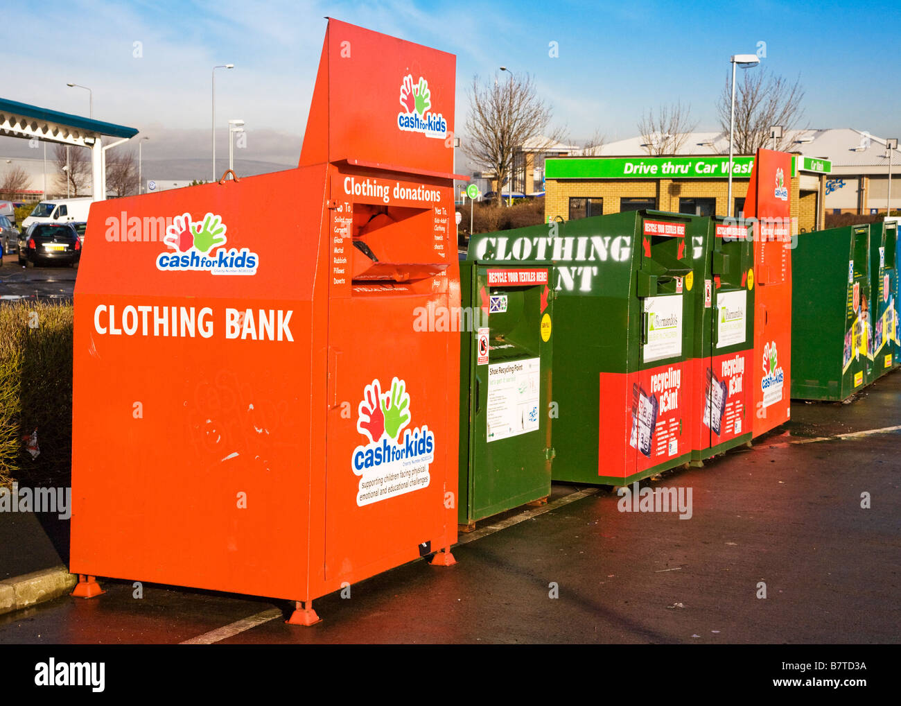 A Bank of recycling bins in a supermarket car park. Stock Photo