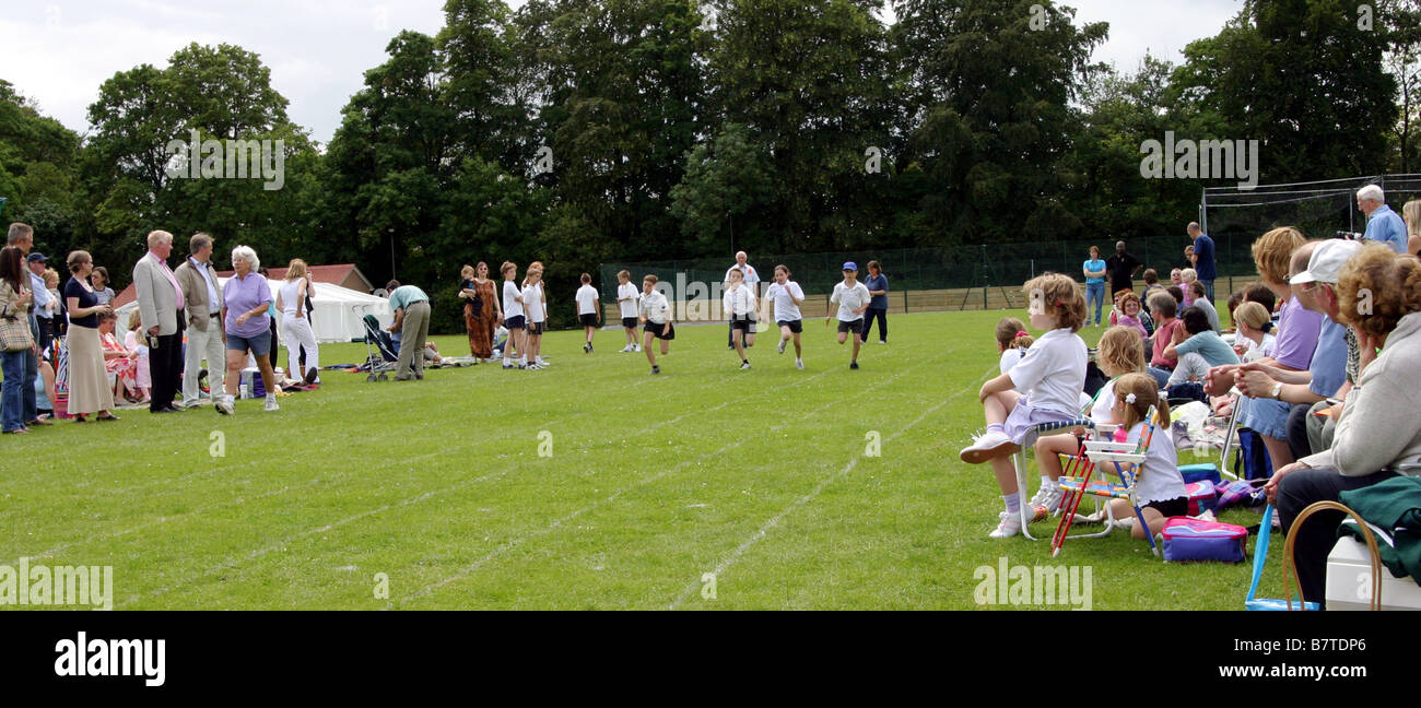 Children in a running race, Primary school sports day, England UK - Stock Image