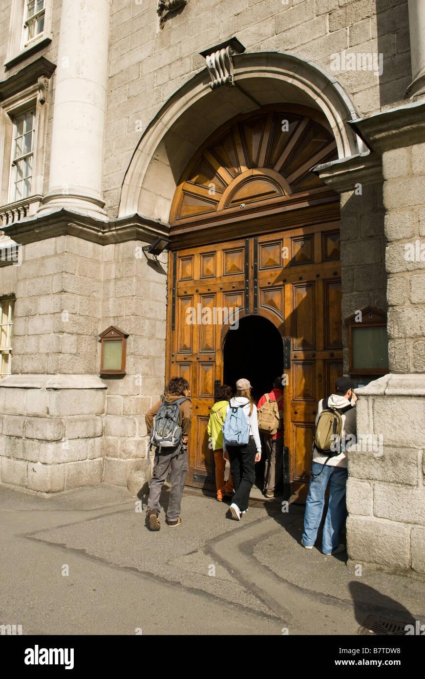 People walking through Trinity College front door Dublin Ireland