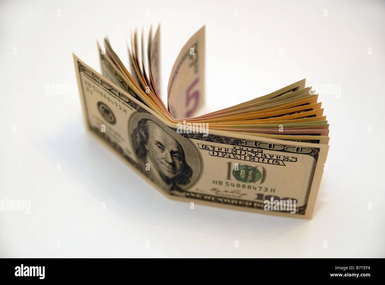 A wad of US dolla bank notes currency money - Stock Image