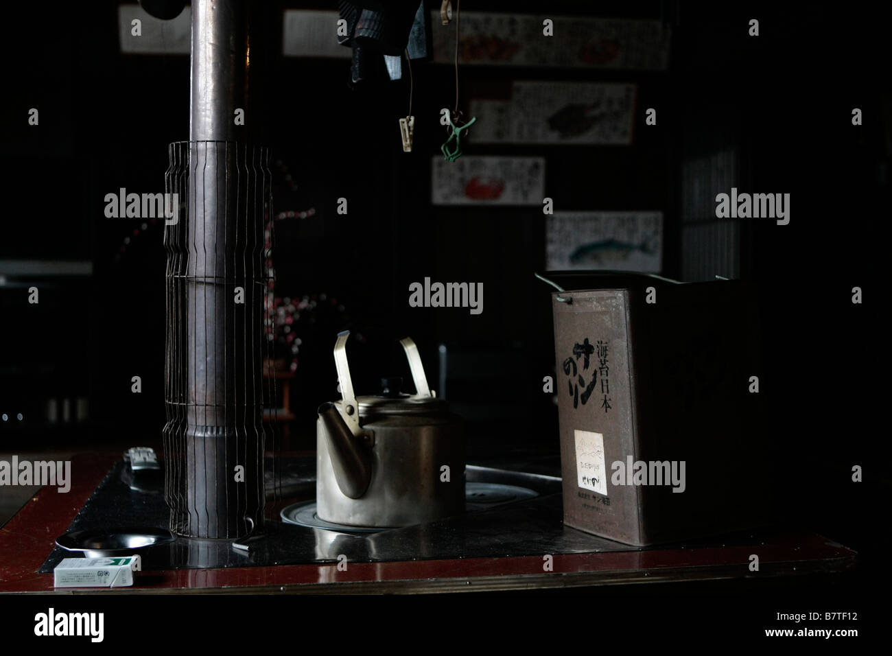 An old kettle and tea box on a stove in a traditional guesthouse in Shirikawa-Go, Japan - Stock Image