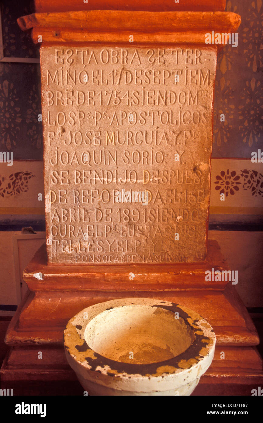 Baptismal font in Mission San Miguel Arcangel. Completed in 1754, this mission is located in Conca, Queretaro, Mexico. - Stock Image