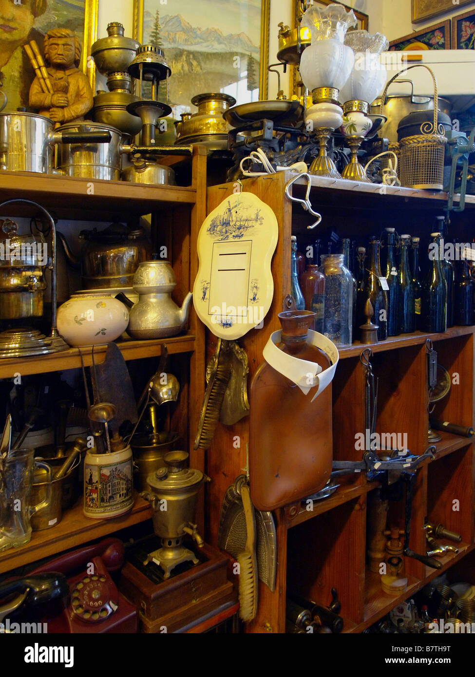 Antique lamps, kitchen items, and other decor on sale at an antiques ...