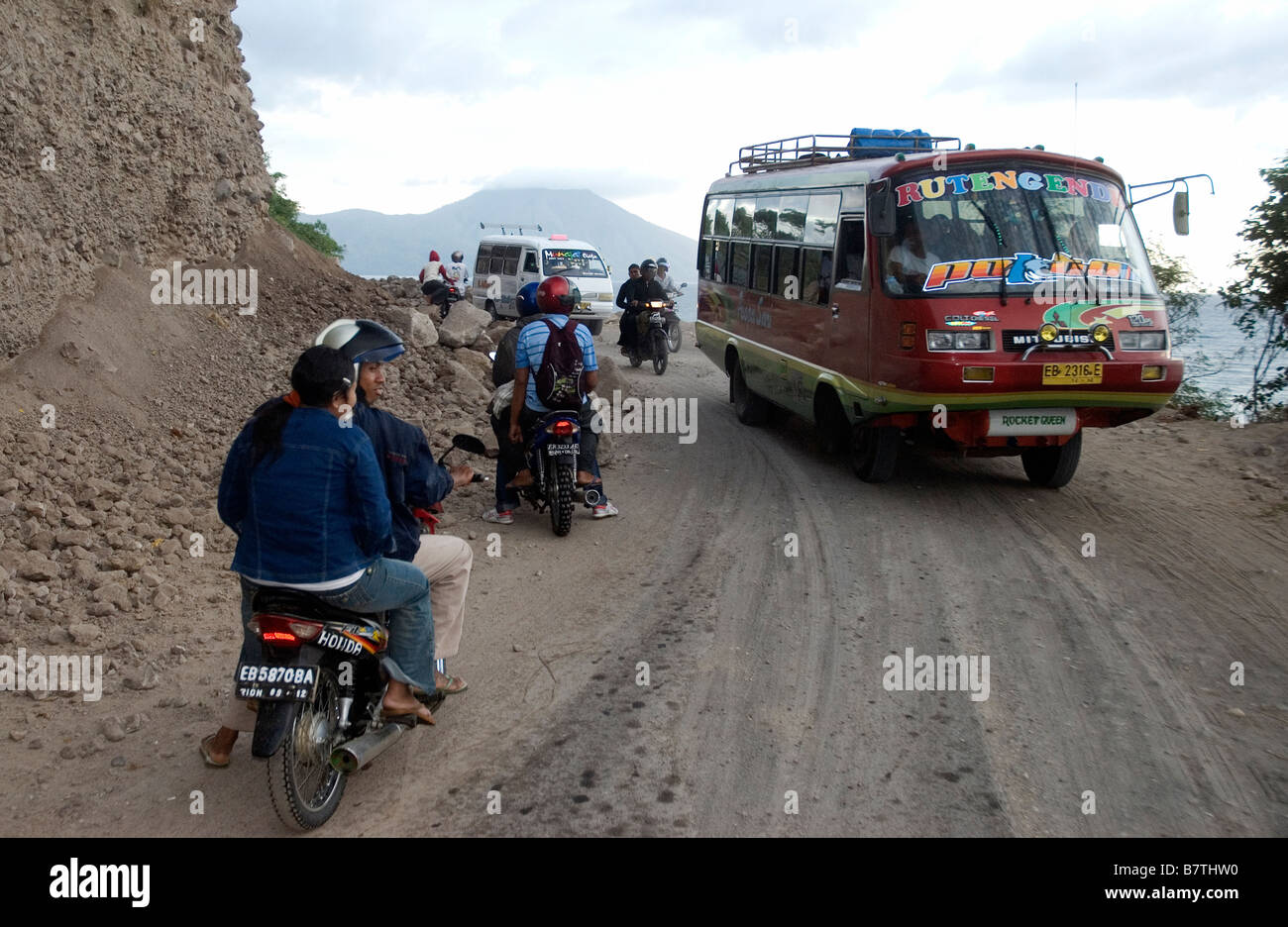 Section of trans Flores Highway near Ende Gunung Mej volcano in background - Stock Image