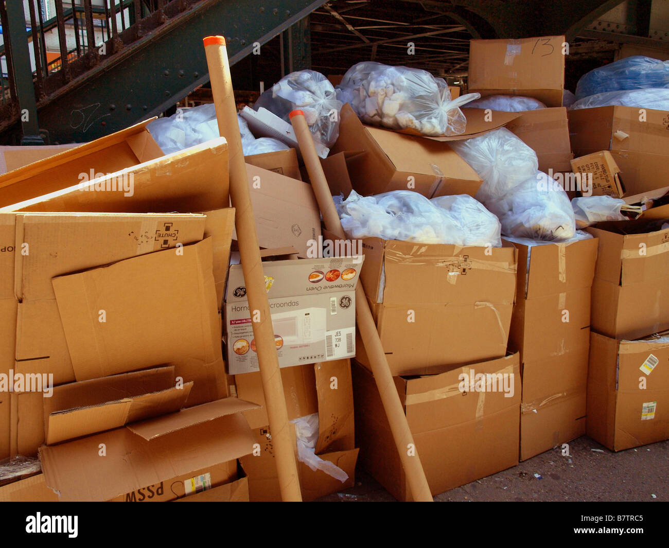 Piles of trash and recycling on the side of the street in Astoria, Queens, New York City. - Stock Image