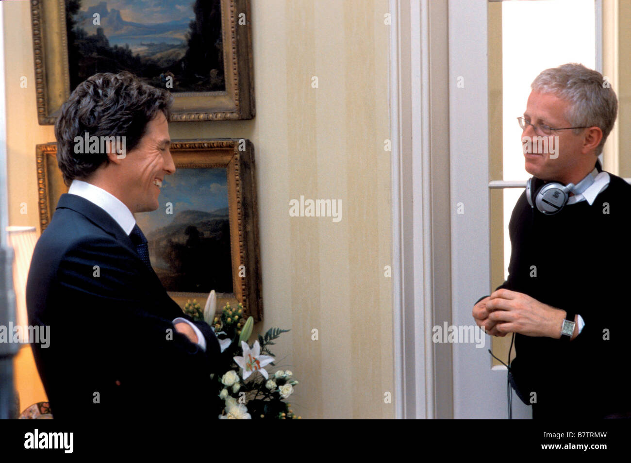 Love Actually  2003 USA Director : Richard Curtis Hugh Grant, Richard Curtis Shooting picture - Stock Image
