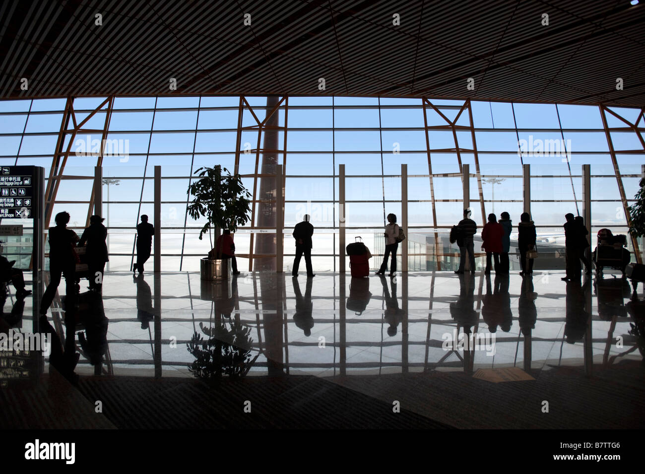 Passengers in new terminal 3 building at Beijing Airport China 2009 - Stock Image