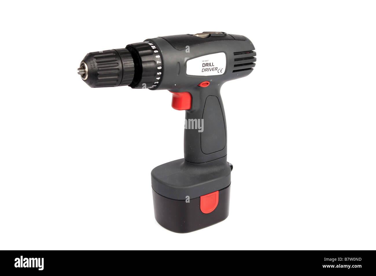 A chordless power drill against a white background - Stock Image
