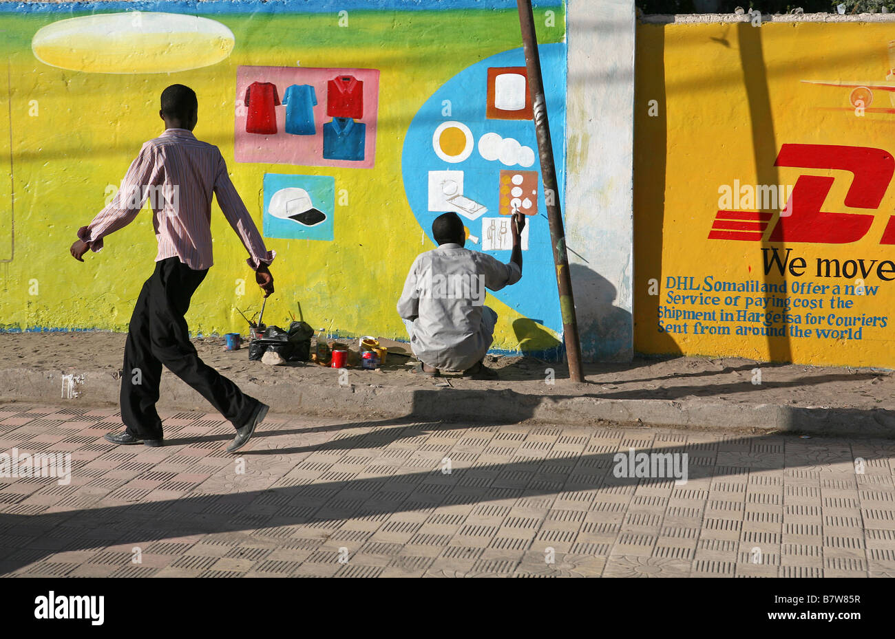 Man painting an advertising mural on a wall, Hargeisa, Somaliland, Somalia, Africa - Stock Image