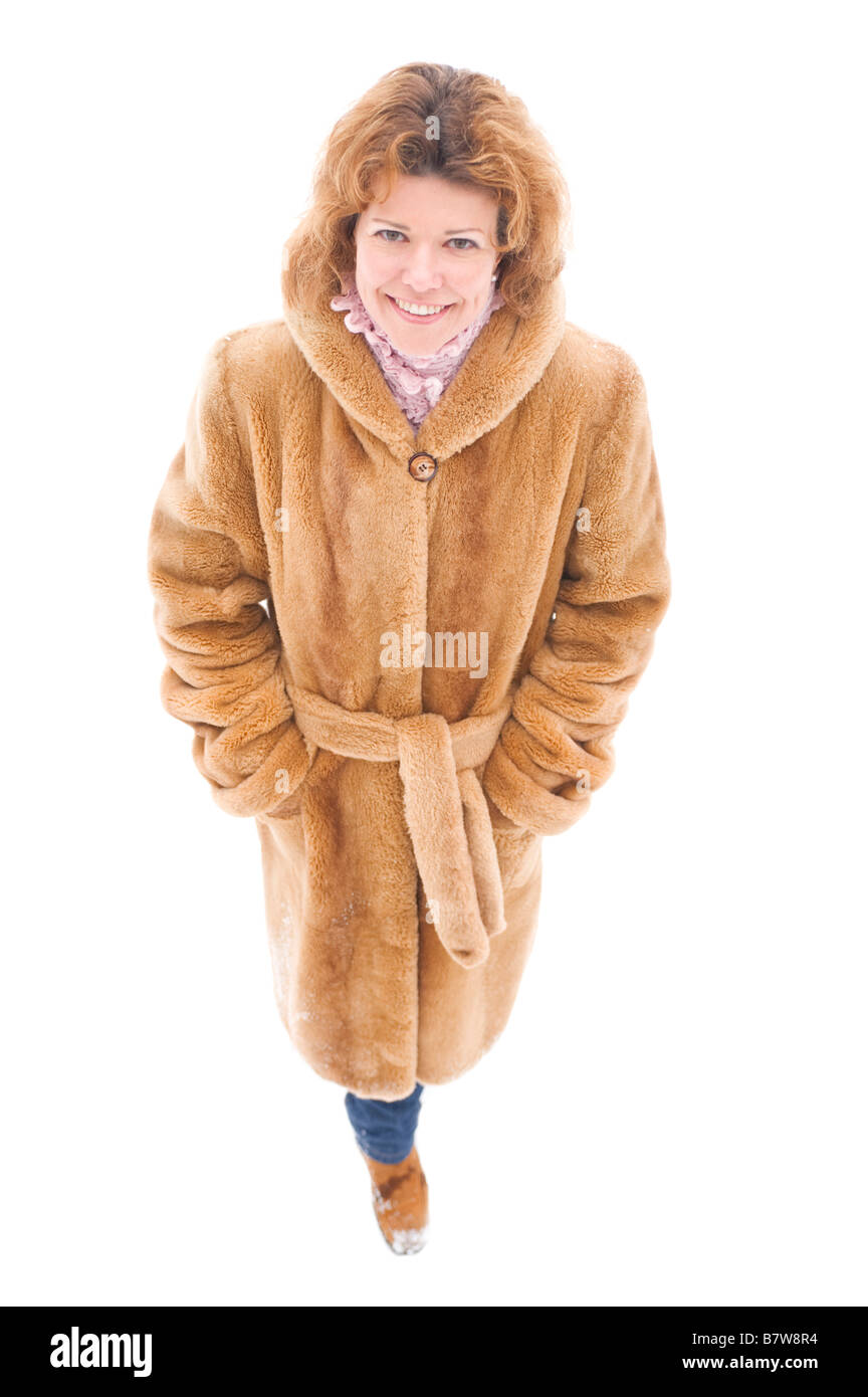 portrait on white woman in the fur coat - Stock Image