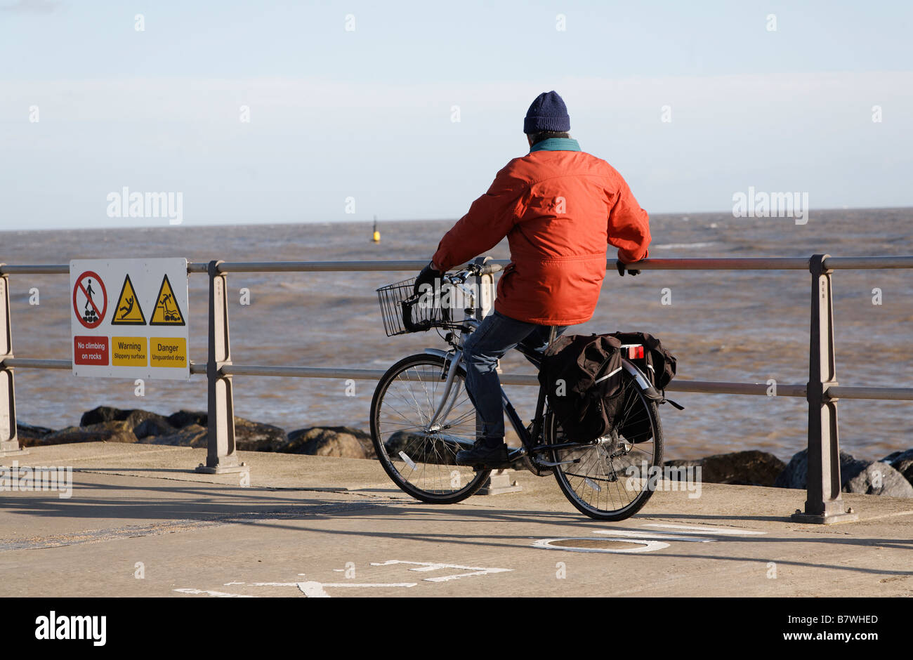 Man on bicycle looking out to sea Ness Point Lowestoft Suffolk England - Stock Image