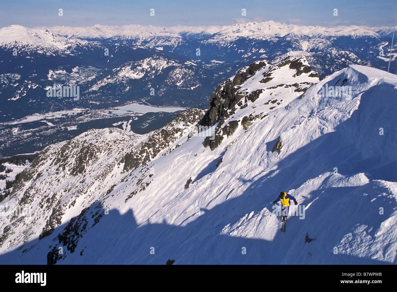 A skier makes an off-piste run at Blackcomb, Whistler Blackcomb Resort, British Columbia. - Stock Image