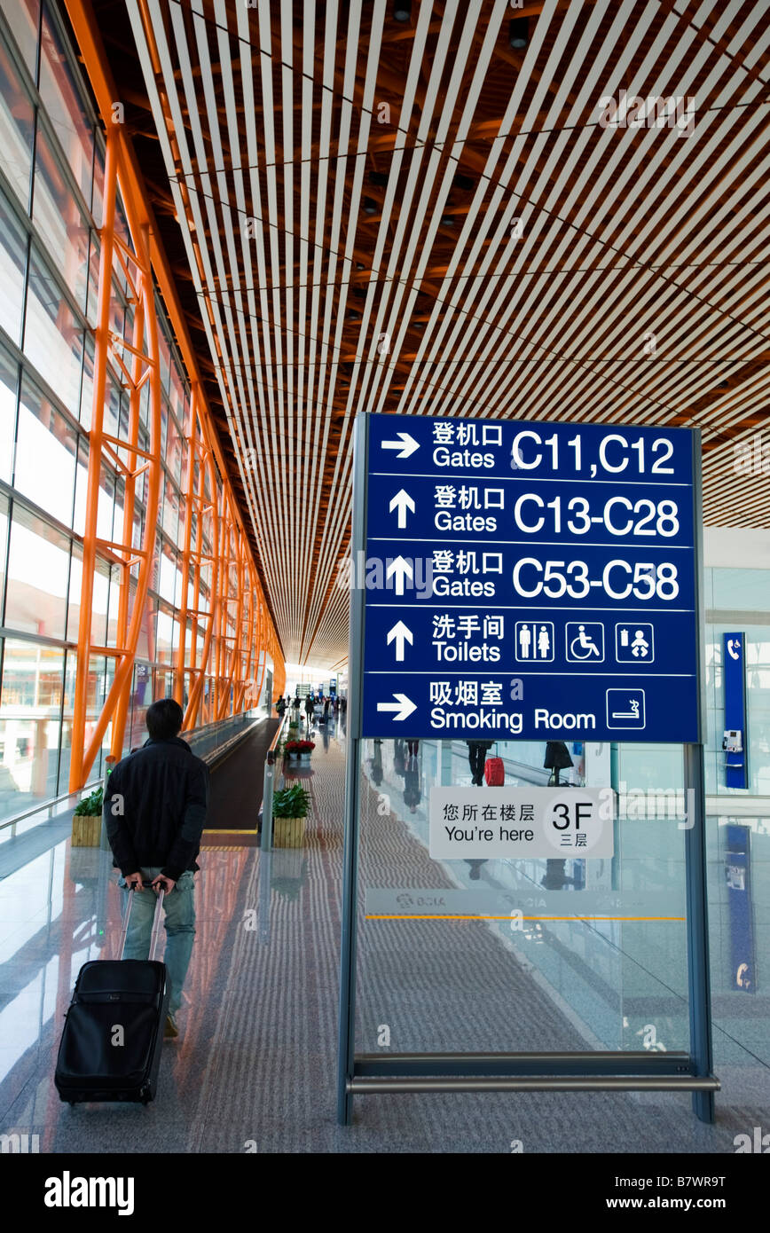 Modern departure gate information board at new Beijing Airport Terminal 3 China 2009 - Stock Image