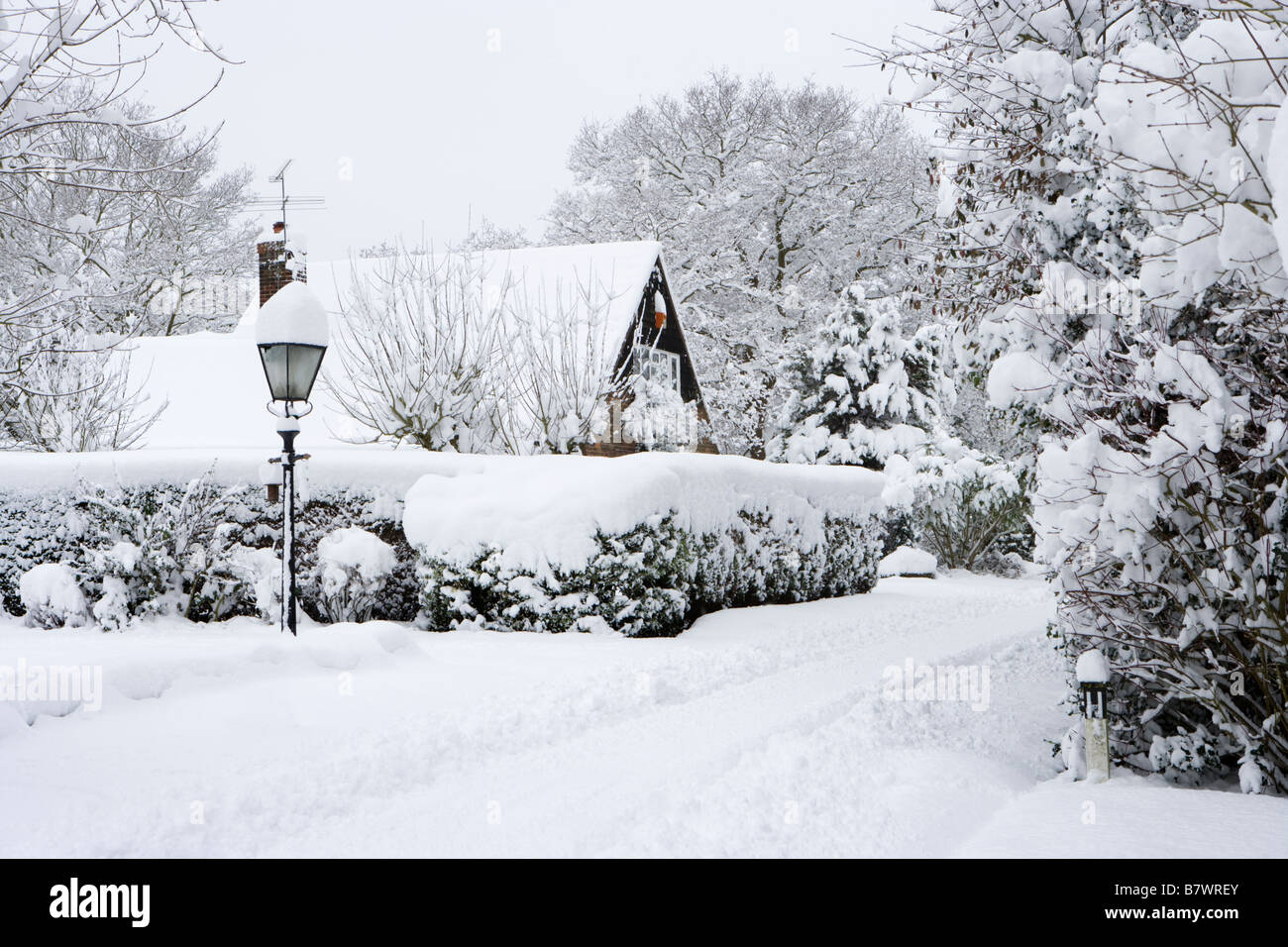 Residential road after heavy snow fall. Send, Surrey, UK - Stock Image