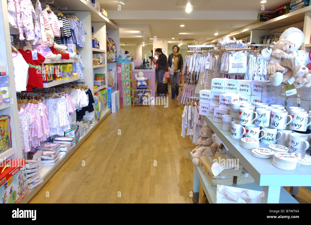 Shelving And Display Racks Stocked With Baby Clothing For Sale In