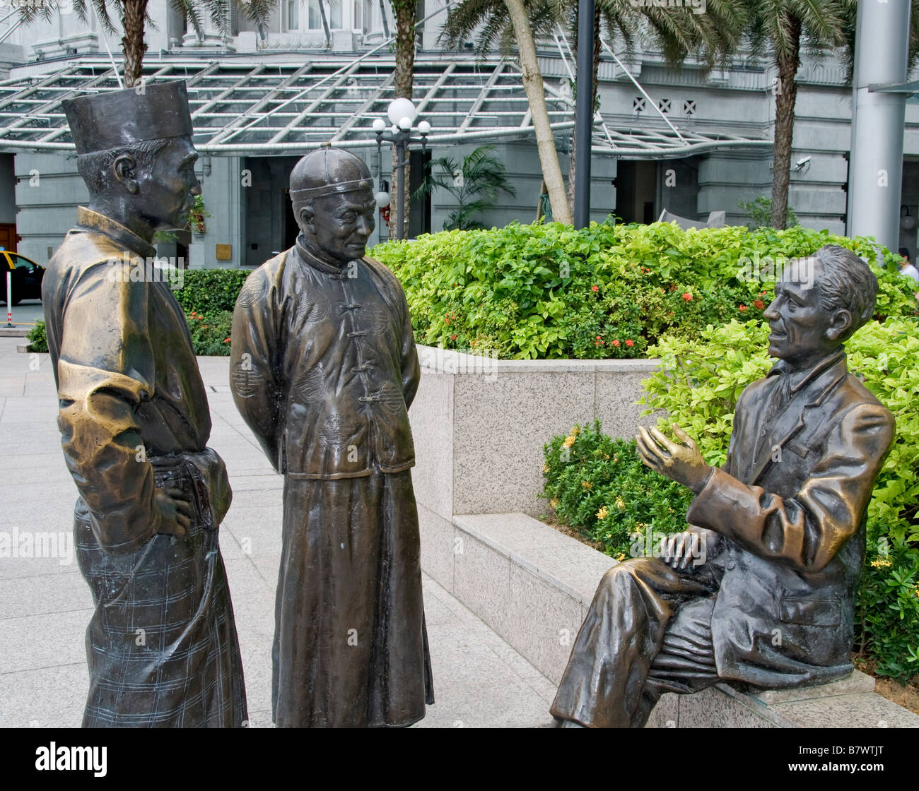 The river merchants by AW Tee Long sculptor statue sculpture Singapore river downtown Chinatown CBD - Stock Image