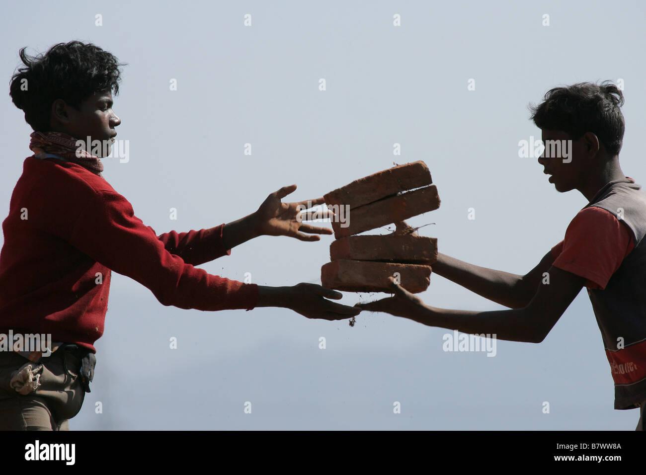Boys throwing bricks - Stock Image