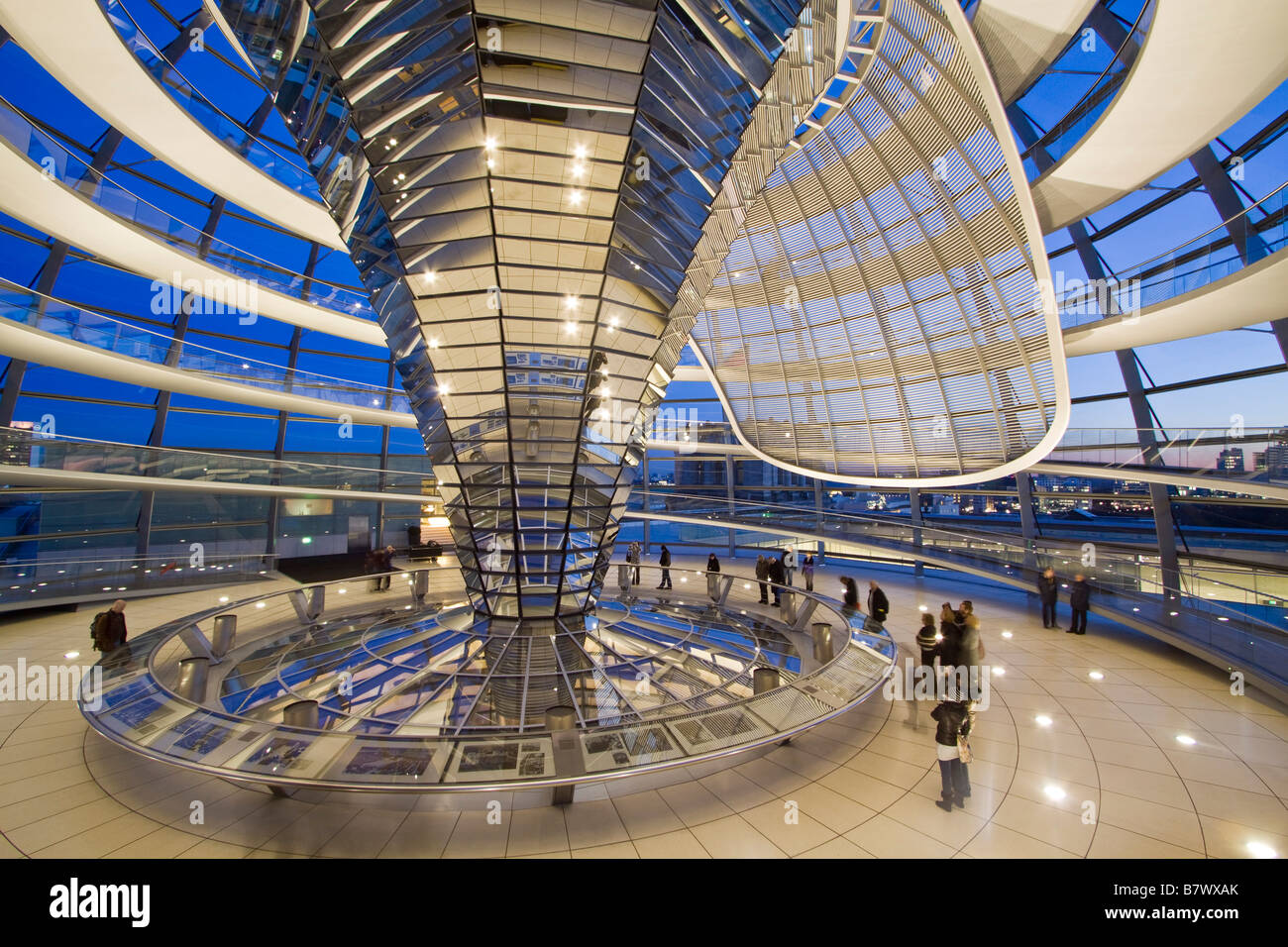 Reichstag buiding cupola by Sir Norman Forster at twilight group of people Berlin - Stock Image