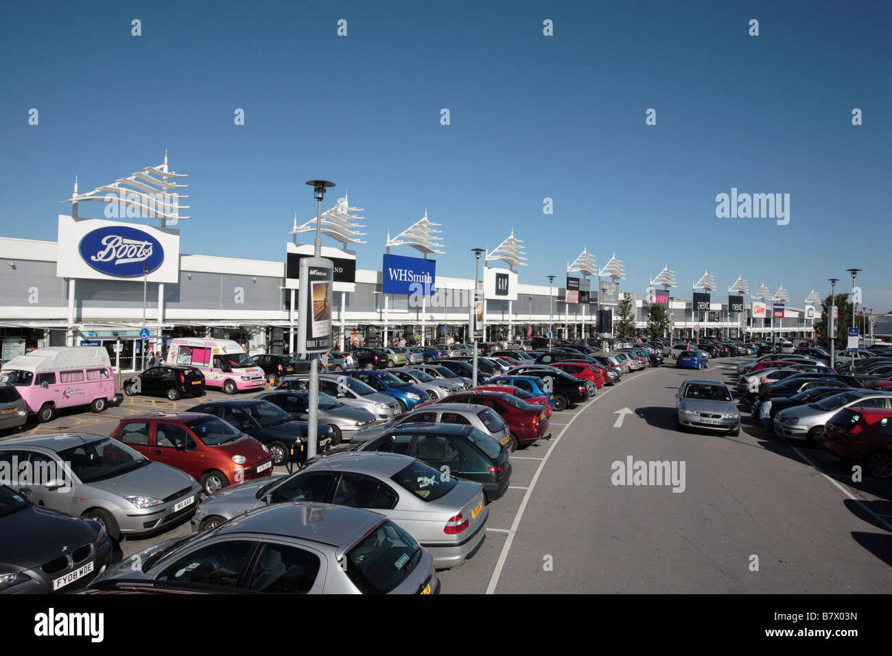 Terrace of shop units, Birstall Shopping Park, West Yorkshire - Stock Image