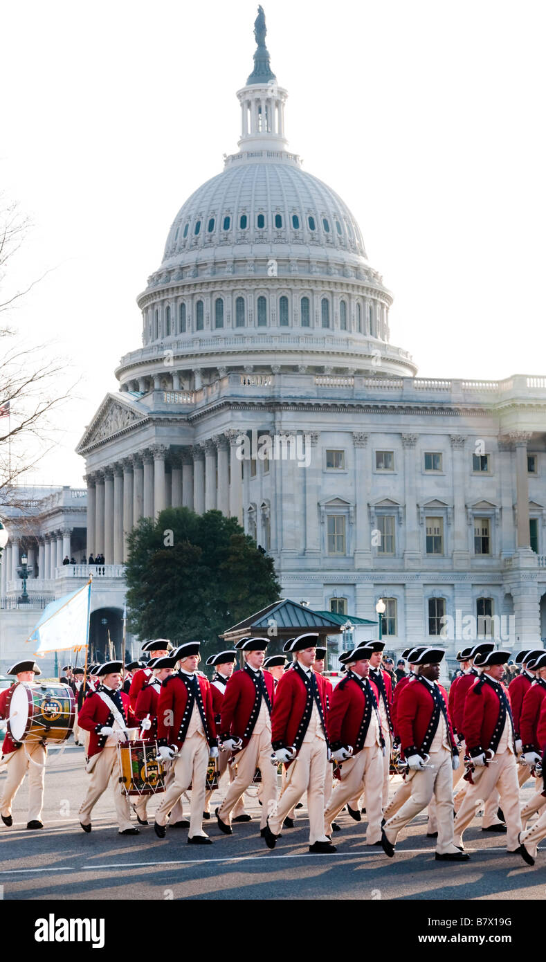 A formation of marchers in colonial garb march past the US Capitol in the 2009 inaugural parade of President Barack - Stock Image