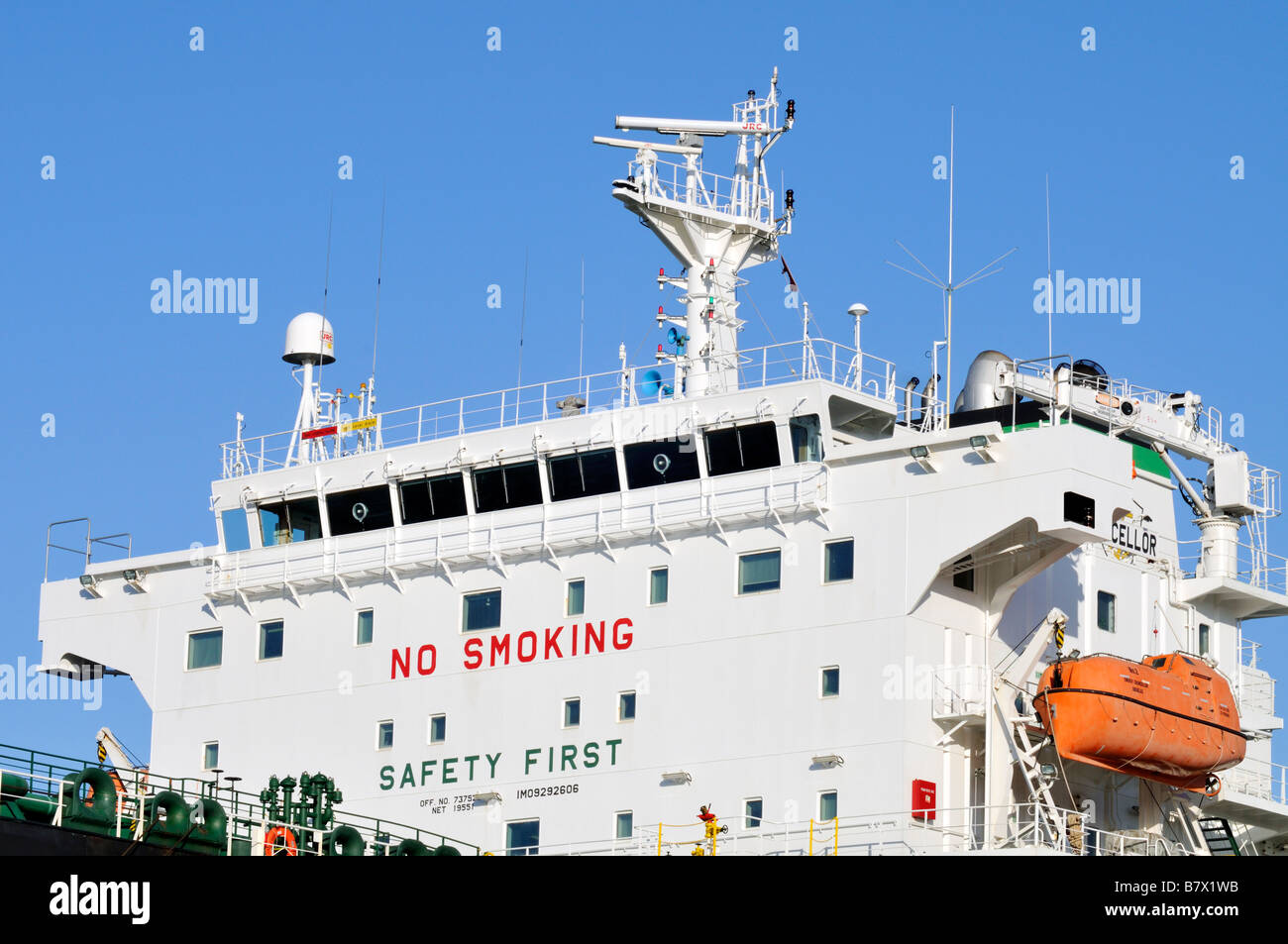 Ship's bridge or superstructure showing radar electronics lifeboat 'no smoking' and [safety first signs] - Stock Image