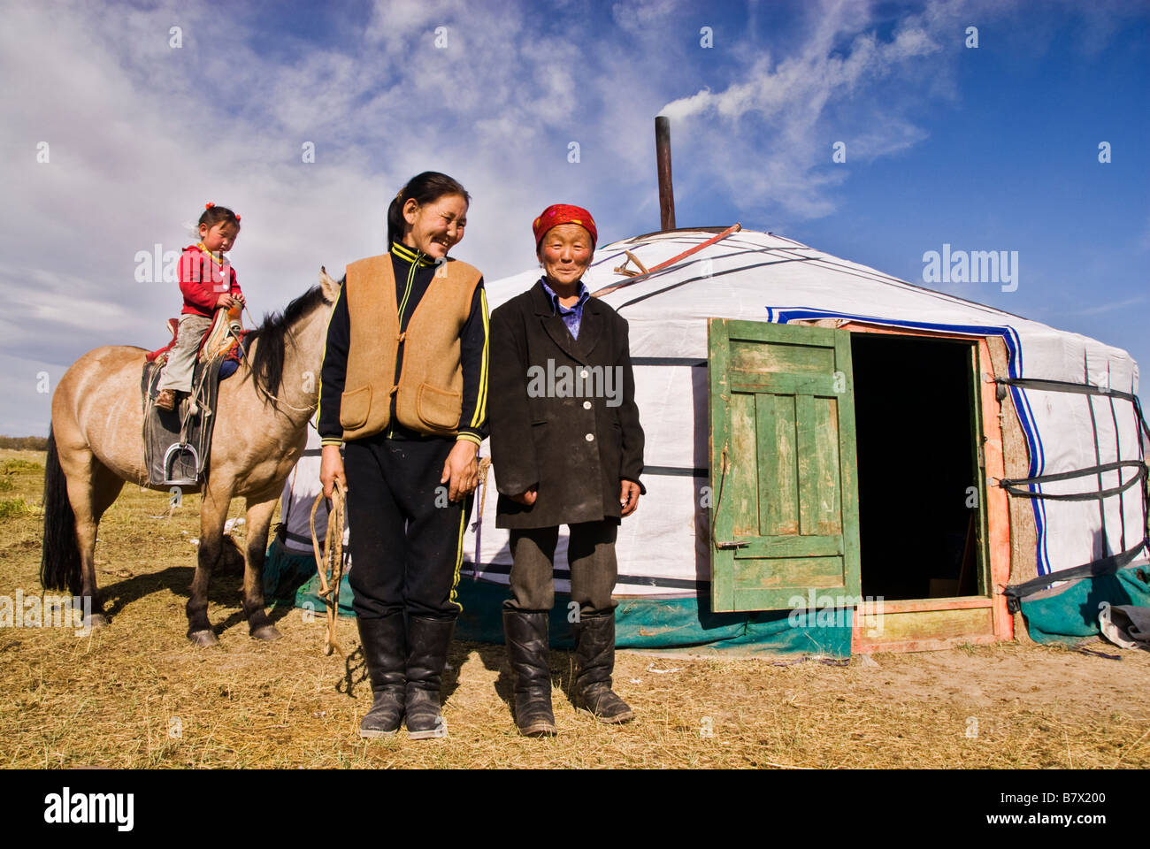 Mongolian family in a yurt Mongolian steppe - Stock Image