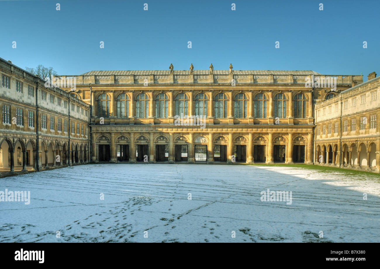 The Wren Library at the far end of Neville s Court of Trinity College Cambridge after an unusually heavy snowfall. - Stock Image