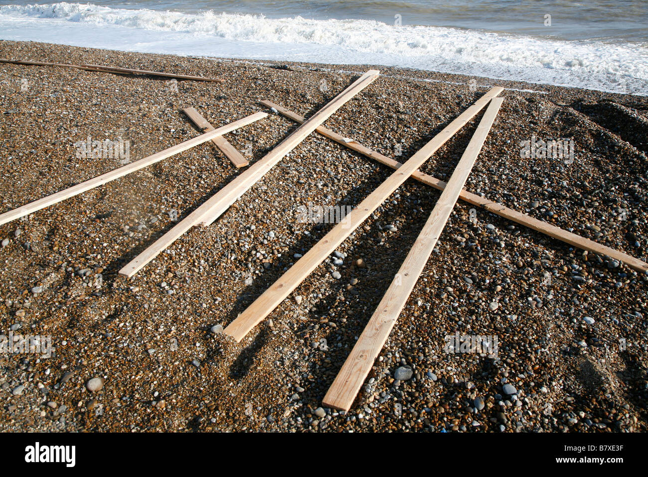 Timber planks washed ashore from stricken cargo ship Suffolk England January 2009 - Stock Image