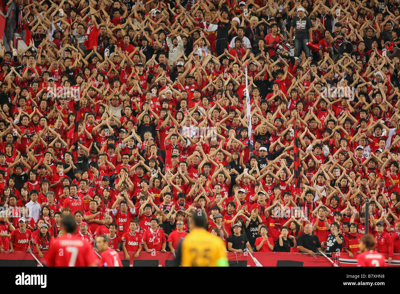 Reds Fans SEPTEMBER 24 2008 Football AFC Champions League 2008 between Urawa Red Diamonds 2 0 Al Qadsia at Saitama - Stock Image