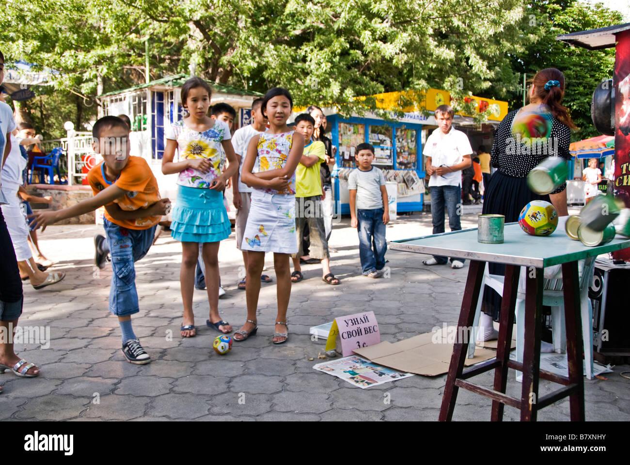 Boys playing in a fair game Bishkek Kyrgyzstan - Stock Image