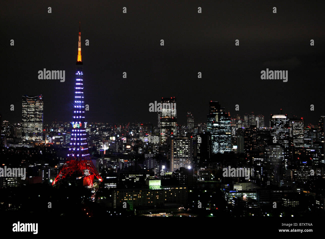 Against the backdrop of Tokyo s skyscrapers and night sky Tokyo Tower is lit  by 180 Landmark Lights on December 1 2008 marking the 50th anniversary of  Tokyo ... afb44fb0c793f